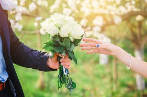 groom gives his bride a beautiful wedding bouquet.
